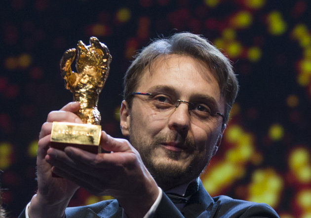 Director Calin Peter Netzer holds the Golden Bear for his film Child&#39;s Pose at the closing ceremony at the 63rd edition of the Berlinale, International Film Festival in Berlin, Saturday, Feb. 16, 2013. (AP Photo/Gero Breloer)