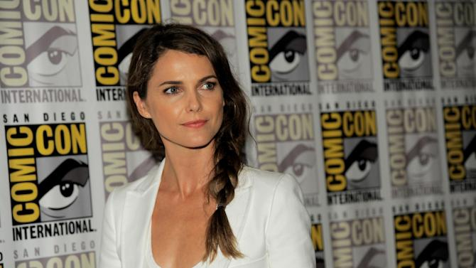 "FILE - In a Saturday, July 20, 2013 photo, Keri Russell attends the ""Dawn of the Planet of the Apes"" press line on Day 4 of Comic-Con International in San Diego, Calif. New York City police say thieves broke into Keri Russell's Brooklyn home early Wednesday, Dec. 4, 2013 while the actress was sleeping and stole a laptop, jewelry and a purse. (Photo by Chris Pizzello/Invision/AP, File)"