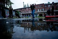 Urban golf players play golf at a disused brewery in Berlin on July 16. Urban golf, also known as cross golf or street golf, has found a natural home among Berlin's wide open urban spaces and abandoned buildings