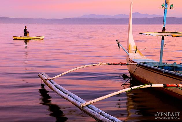 The sun sets on fishermen on Taal Lake. The lake is known for the maliputo and tawilis harvested from its waters. (Yen Baet)