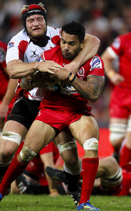Queensland Reds centre Digby Ioane (R) is tackled by Golden Lions lock Franco Van Der Merwe during their Super 15 rugby union match at Suncorp Stadium in Brisbane on May 19, 2012.  IMAGE STRICTLY REST