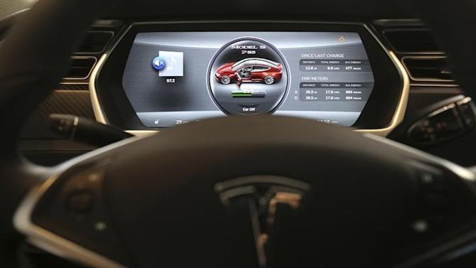 The dashboard of a Tesla Model S is shown at a Tesla Motors dealership at Corte Madera Village, an outdoor retail mall, in Corte Madera