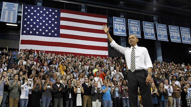 FILE - In this April 24, 2012, file photo President Barack Obama acknowledges the crowd after speaking at the University of North Carolina in Chapel Hill, N.C. Demographic changes and recent election results reveal a more nuanced landscape in southern states now as the two major parties prepare for their national conventions. Republicans convene Aug. 27 in Florida, a melting-pot battleground state, to nominate Mitt Romney of Massachusetts. Democrats will toast Barack Obama the following week in North Carolina, the perfect example of a Southern electorate not so easily pigeon-holed. (AP Photo/The News & Observer, Chuck Liddy, Pool)