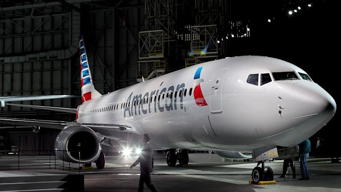 American Airlines unveils a new company logo and exterior paint scheme on a Boeing 737-800 aircraft on January 17, 2013 in Dallas, Texas