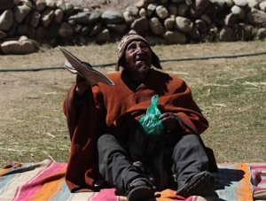 Aymara Indian Flores gestures before chewing coca leaves …