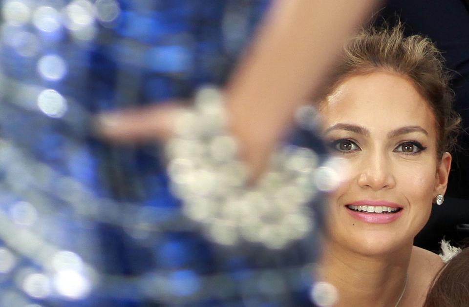 "File- This Oct. 2, 2012 file photo shows Jennifer Lopez watching Chanel's ready to wear Spring-Summer 2013 collection, presented in Paris. A person familiar with negotiations to bring Lopez back as an ""American Idol"" judge said her return will be announced this week. (AP Photo/Thibault Camus, File)"