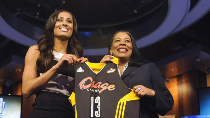 Skylar Diggins holds up a Tulsa Shock jersey with WNBA President Laurel J. Richie after Tulsa selected Diggins as the No. 3 pick in the WNBA basketball draft in Bristol, Conn., Monday, April 15, 2013. (AP Photo/Jessica Hill)