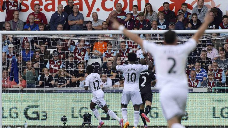 Swansea City's Nathan Dyer celebrates scoring a goal against Burnley during their English Premier League soccer match at the Liberty Stadium in Swansea