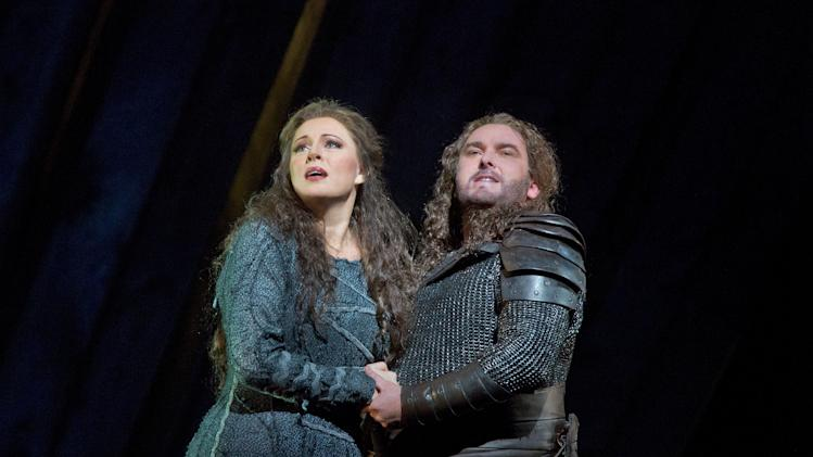 "CORRECTS SPELLING TO WALKUERE  In this April 10, 2013 photo provided by the Metropolitan Opera Martina Serafin as Sieglinde and Simon O'Neill as Siegmund perform in the final dress rehearsal of Wagner's ""Die Walkuere,"" at the Metropolitan Opera in New York. (AP Photo/Metropolitan Opera, Ken Howard)"