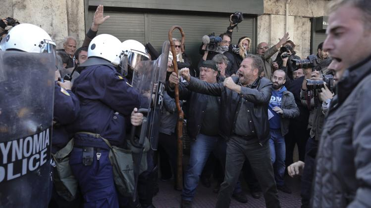 Farmers argue with policemen during a rally outside the parliament in Athens