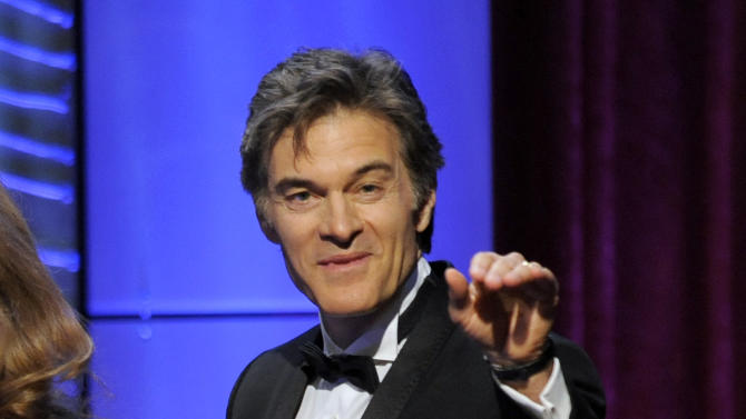 """This June 16, 2013 file photo shows Mehmet Oz, aka Dr. Oz, accepting the award for outstanding talk show: informative for """"The Dr. Oz Show"""" at the 40th Annual Daytime Emmy Awards in Beverly Hills, Calif. Oz is following in the footsteps of TV personalities like Oprah Winfrey, Rachael Ray and Martha Stewart by launching his own women's magazine. The Emmy Award-winning host has teamed up with Hearst to release the lifestyle magazine. In a statement, Oz said it """"will provide women with everything they need to feel inspired and live a long, healthy, joyful life."""" Two trial issues will be released in the first quarter of 2014. (Photo by Chris Pizzello/Invision/AP, file)"""