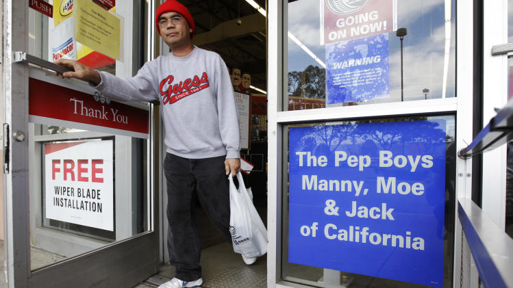 Customer leaves a Pep Boys - Manny, Moe & Jack auto parts store in Hayward, Calif., Monday, Jan. 30, 2012. The Pep Boys - Manny, Moe & Jack, an auto parts chain founded more than 90 years ago, has agreed to be taken private by the investment firm The Gores Group for about $791 million. (AP Photo/Paul Sakuma)