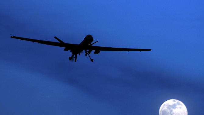 FILE - In this Jan. 31, 2010 file photo, an unmanned U.S. Predator drone flies over Kandahar Air Field, southern Afghanistan, on a moon-lit night. The U.S. and Pakistan are starting to look more like enemies than friends, threatening the U.S. fight against Taliban and al-Qaida militants based in the country and efforts to stabilize neighboring Afghanistan before American troops withdraw. (AP Photo/Kirsty Wigglesworth, File)