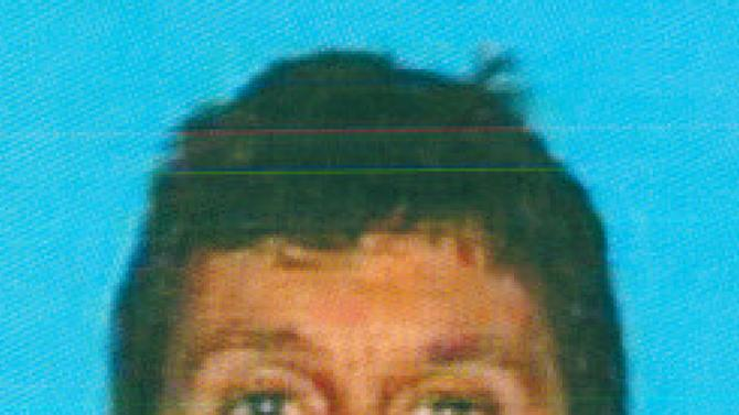 This image provided by the California Department of Motor Vehicles shows Ronald Franklin Gilbert, 52, of Huntington Beach, calif., who was shot and killed by a 75-year-old retired barber, Stanwood Fred Elkus, on Jan. 28, 2013 at his office in Newport Beach, Calif. The retired barber accused of the shooting Gilbert to death in his exam room suffered from prostate problems and was angry about his incontinence after a recent surgery, neighbors said Tuesday. (AP Photo/Calif DMV)