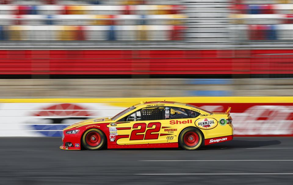 Joey Logano drives his car down the front stretch during testing for the NASCAR Sprint Cup auto racing series at Charlotte Motor Speedway in Concord, N.C., Tuesday, Dec. 11, 2012. (AP Photo/Chuck Burton)