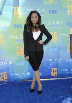 """FILE - In this Aug. 7, 2011 photo, Raven-Symone arrives at the Teen Choice Awards in Universal City, Calif.   Raven-Symone is all grown up, and going to a convent. The former """"The Cosby Show"""" actress will take over the lead part in Broadway's hit musical """"Sister Act"""" later this month, playing a nightclub-singer-turned-nun.  (AP Photo/Dan Steinberg)"""