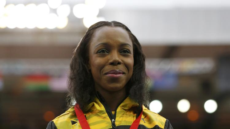 Campbell-Brown of Jamaica stands with her gilver medal for Women's 100m at the Commonwealth Games in Glasgow