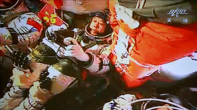 In this image made off the monitor screen at the Beijing Aerospace Flight Control Center and released by China's Xinhua News Agency, China's astronauts Jing Haipeng, center, Liu Wang, left with face not visible, and Liu Yang sit inside the Shenzhou-9 manned spacecraft while conducting docking with the Tiangong-1 space lab module Monday afternoon, June 18, 2012, 343 kilometers (213 miles) above Earth. (AP Photo/Beijing Aerospace Control Center via Xinhua) NO SALES
