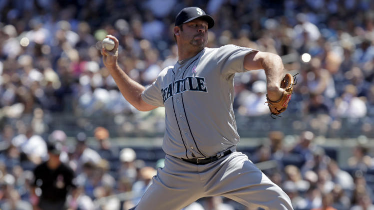 Seattle Mariners starting pitcher Kevin Millwood throws during the first inning of a baseball game against the New York Yankees at Yankee Stadium in New York, Sunday, May 13, 2012. (AP Photo/Seth Wenig)