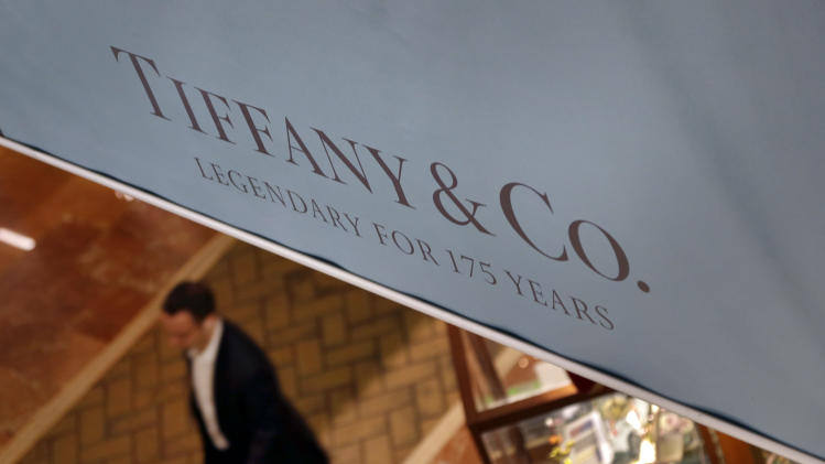 FILE - In this Tuesday, Nov. 27, 2012, file photo, a man walks pastg Tiffany & Co. sign in Boston. Tiffany & Co. reports quarterly earnings on Tuesday, Aug. 27, 2013. (AP Photo/Elise Amendola, File)