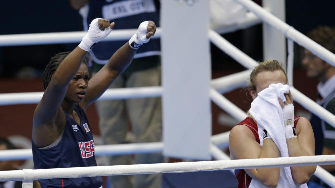 Kazakhstan's Marina Volnova, right, and United States' Claressa Shields react following their middleweight 75-kg semifinal boxing match at the 2012 Summer Olympics, Wednesday, Aug. 8, 2012, in London. (AP Photo/Patrick Semansky)