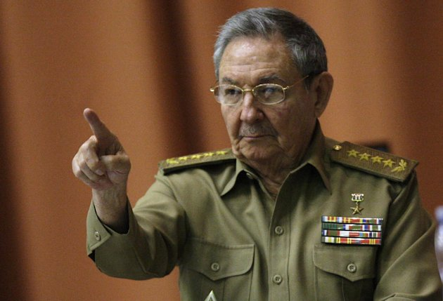 Cuba&#39;s President Raul Castro points as he attends a session of the National Assembly in Havana, Cuba, Thursday, Dec. 13, 2012. The session is one of the National Assembly&#39;s twice-yearly gatherings. (AP Photo/Ismael Francisco, Cubadebate)