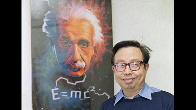 FILE - This Nov. 4, 1988 file photo shows Chinese astrophycisist Fang Lizhi next to a poster of Albert Einstein in Beijing. Fang, one of China's best-known dissidents whose speeches inspired student protesters throughout the 1980s, died Friday, April 6, 2012 in the United States, where he fled after China's 1989 military crackdown on the pro-democracy movement. He was 76. (AP Photo/Mark Avery, File)