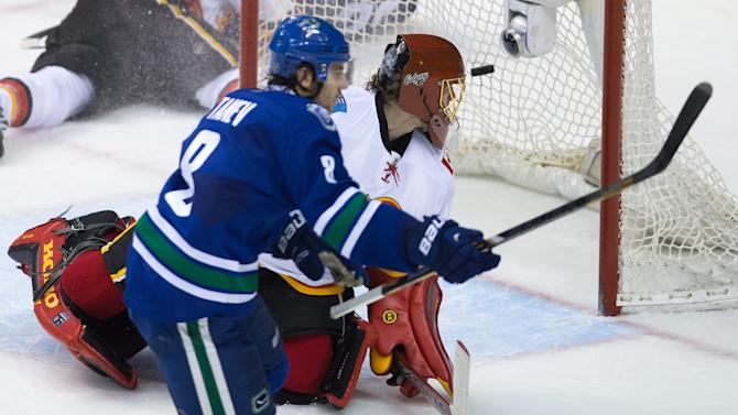 Tanev lifts Canucks over skidding Flames 3-2 in OT