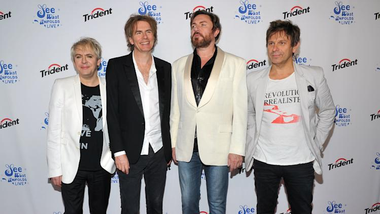"FILE -  In this June 20, 2012 file photograph originally released by Trident, members of Duran Duran, from left, Nick Rhodes, John Taylor, Simon Le Bon and Roger Taylor make an appearance at Trident's ""See What Unfolds Live"" event at Terminal 5 in New York. The band is canceling several concerts because of the illness of keyboard player Nick Rhodes. They had already called off concerts over the past week in Pittsburgh; in Kettering, Ohio; outside Chicago; and in Atlantic City, N.J. The band had hoped to reschedule some of the shows, but decided to cancel the final half-dozen shows on its North American tour.  (AP Photo/Trident, Diane Bondareff, file)"