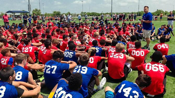 In this April 27, 2014 photo provided by Donald Hooton Sr., Donald Hooton Jr. addresses players at the USA Football regional football camp about the potential dangers of using performance-enhancing substances at the Houston Sports Park in Houston. Experimentation with human growth hormones by America's teens more than doubled in the last year, according to a large-scale national survey. Hooton works for the Taylor Hooton Foundation, named after his brother, Taylor, a 17-year-old high school athlete whose suicide in 2003 was blamed by his family on abuse of steroids. (AP Photo/Donald Hooton Sr.)