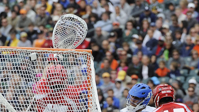 Duke's Jordan Wolf, middle, shoots and scores a goal around Cornell's Jason Noble (45) and AJ Fiore (47) during the first half of an NCAA division 1 semifinal lacrosse game on Saturday, May 25, 2013, in Philadelphia. (AP Photo/Michael Perez)