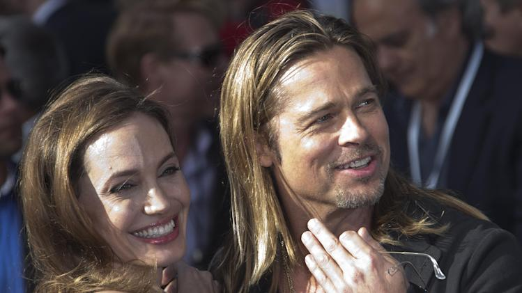 Brad Pitt and Angelina Jolie arrive for the World Premiere of World War Z at a central London cinema, Sunday, June 2, 2013. (Photo by Joel Ryan/Invision/AP)