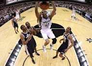 Tim Duncan of the San Antonio Spurs gets a slam dunk against the Utah Jazz in Game One of the Western Conference Quarterfinals in the 2012 NBA Playoffs at AT&T Center in San Antonio, Texas. Tony Parker scored 28 points and Duncan added 17 to lead the San Antonio Spurs over the Utah Jazz 106-91 on Sunday in the opening game of their NBA Western Conference playoff series