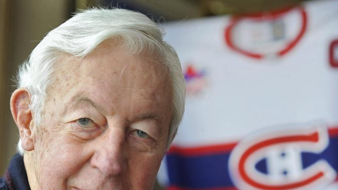 """In this Nov. 25, 2009, file photo, Montreal Canadiens great Jean Beliveau is shown during an interview about his hockey career at his home in St. Lambert, Quebec. Beliveau has had a stroke and is being treated at a hospital. The NHL team said Tuesday, Feb. 28, 2012, the 80-year-old Hall of Famer was admitted after he was stricken Monday night. The Canadiens say Beliveau is """"undergoing active investigation and treatments."""" (AP Photo/The Canadian Press, Graham Hughes, File)"""