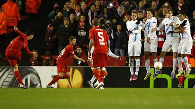 Liverpool's Luis Suarez (L) shoots to score from a free kick against Zenit St. Petersburg during their Europa League soccer match at Anfield in Liverpool, northern England, February 21, 2013. REUTERS