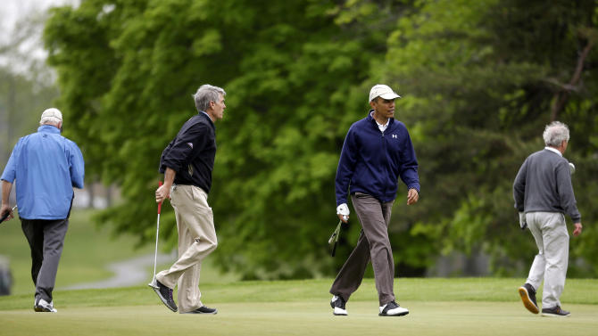 President Barack Obama with, from left to right, Sen. Saxby Chambliss, R-Ga., Sen. Mark Udall, D-Colo., and Sen. Bob Corker, R-Tenn., on the golf course at Andrews Air Force Base, Md., Monday, May 6, 2013. (AP Photo/Pablo Martinez Monsivais)
