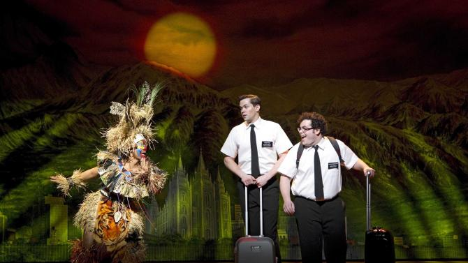 """FILE - In this undated file image released by Boneau/Bryan-Brown, from left, Rema Webb, Andrew Rannells and Josh Gad perform in """"The Book of Mormon"""" in New York. The musical took in $2,802,606 over eight shows for the week ending Sunday, Feb. 9, 2014, at Atlanta's 4,678-seat Fox Theatre. It takes the crown from """"Wicked,"""" which had a one-week gross of $2,755,070 at the Fabulous Fox Theatre in St. Louis in 2012. (AP Photo/Boneau/Bryan-Brown, Joan Marcus)"""