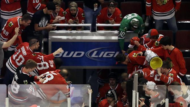 Chicago Blackhawks enter the ice for warmups before Game 7 of the NHL hockey Stanley Cup Western Conference semifinals on Wednesday, May 29, 2013, in Chicago. (AP Photo/Nam Y. Huh)