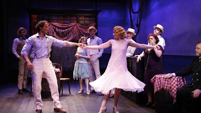 "Shown in a publicity photo released by Shirley Herz Associates are, left foreground, Patrick Cummings dancing with Margaret Loesser Robinson, with the ensemble looking on, in a scene from Bob Merrill and George Abbott's musical ""New Girl in Town"", performing off-Broadway at the Irish Repertory Theatre in New York. (AP Photo/Shirley Herz Associates, Carol Rosegg)"