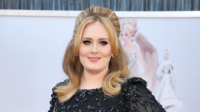 """FILE - In this Feb. 24, 2013 file photo, singer Adele arrives at the Oscars in Los Angeles. Adele's new album """"25"""" has sold more than 2.3 million copies in the United States during its first three days on the market, a stunning number for a music industry that has seen sales steadily fall in the digital era. (Photo by John Shearer/Invision/AP, File)"""