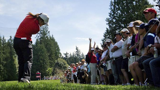 Lydia Ko, of New Zealand, hits her second shot on the eighth hole during the final round of the LPGA Tour's Canadian Women's Open golf tournament, Sunday, Aug. 26, 2012, at the Vancouver Golf Club in Coquitlam, British Columbia. (AP Photo/The Canadian Press, Darryl Dyck)