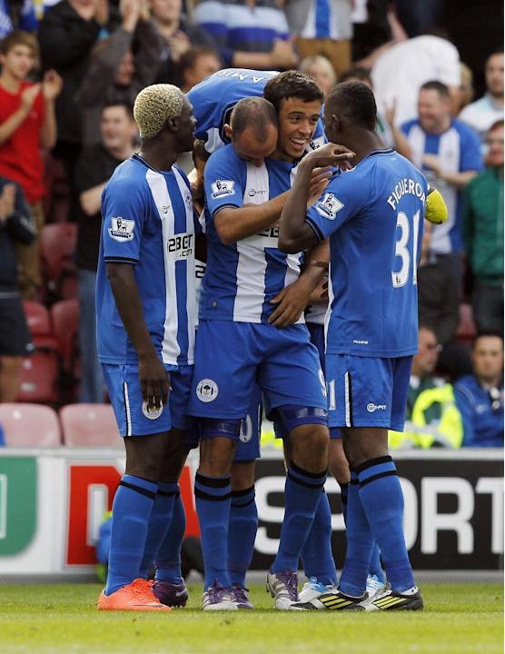 Wigan's Franco Di Santo, centre, has been praised by manager Roberto Martinez