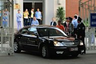 A US Embassy vehicle leaves after visiting blind rights activist Chen Guangcheng at the Chaoyang Hospital in Beijing. Clinton said the United States remained &quot;committed&quot; to the 40-year-old legal campaigner, whose treatment she has repeatedly criticised in the past