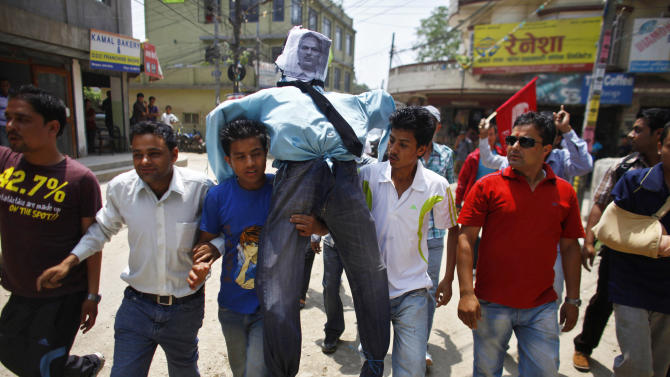 Activists of Nepali Congress-affiliated Nepal Students Union carry an effigy of Prime Minister Baburam Bhattarai before burning it as they demand his resignation in Katmandu, Nepal, Monday, May 28, 2012. Nepal sank into political turmoil Monday after lawmakers failed to agree on a new constitution, leaving the country with no legal government. (AP Photo/Niranjan Shrestha)