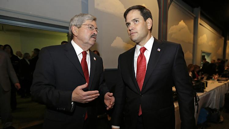 U.S. Sen. Marco Rubio, R-Fla., talks with Iowa Gov. Terry Branstad, left, during Branstad's annual birthday fundraiser, Saturday, Nov. 17, 2012, in Altoona, Iowa. (AP Photo/Charlie Neibergall)
