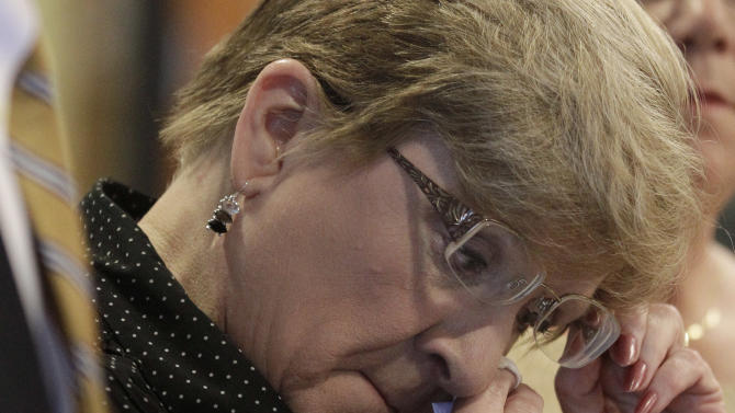 Nanci Koschman, mother of  David Koschman wipes away a tear during a news conference, Monday, Dec. 3, 2012, in Chicago, where Koschman and supporting attorneys responded to the news that  the nephew of former Chicago Mayor Richard Daley was indicted for involuntary manslaughter in the 2004 death of  21-year-old Koschman outside a Chicago bar. A grand jury is continuing its inquiry into how authorities handled the initial investigation and whether there was a cover-up. Richard Vanecko was indicted by a Cook County special grand jury in the death of David Koschman. Koschman died days after he fell and struck his head during a fight with Vanecko outside a bar in Chicago's Gold Coast neighborhood. (AP Photo/M. Spencer Green)