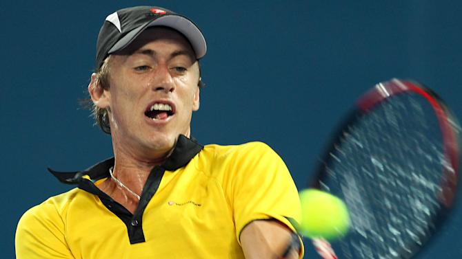 John Millman of Australia plays a shot in his second round match against Andy Murray of Britain at the Brisbane International tennis tournament held in Brisbane, Australia, Thursday, Jan. 3, 2013.  (AP Photo/Tertius Pickard)