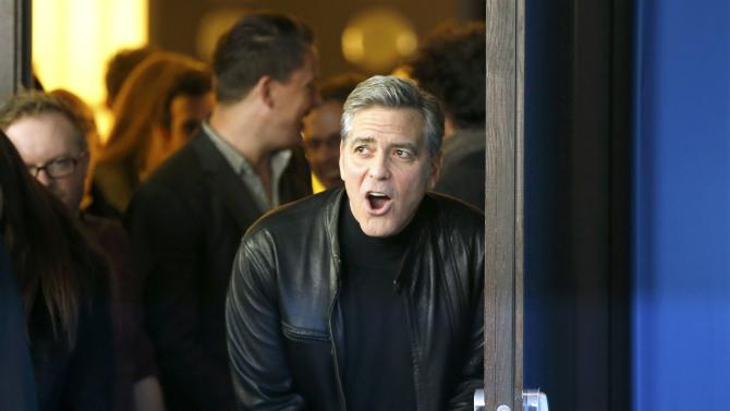 Actor Clooney arrives for photocall at 66th Berlinale International Film Festival in Berlin