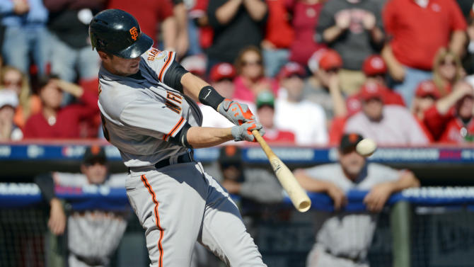 San Francisco Giants' Buster Posey hits a grand slam off Cincinnati Reds starting pitcher Mat Latos in the fifth inning of Game 5 of the National League division baseball series, Thursday, Oct. 11, 2012, in Cincinnati. (AP Photo/Michael Keating)