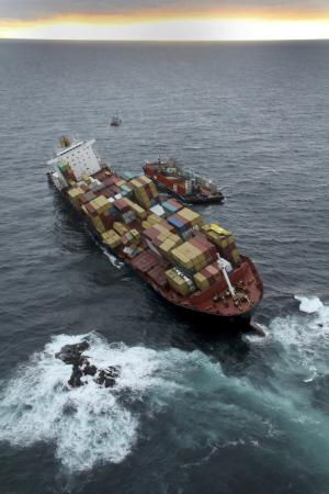 In this Dec. 1, 2011, photo provided by Maritime New Zealand, the cargo ship Rena is hard aground after running full-steam into a well-charted reef off the coast near Tauranga, New Zealand on a calm night on Oct. 5. Australian inspection records show that a cargo ship that ran aground off New Zealand in October had previous safety issues. (AP Photo/Maritime New Zealand, Graeme Brown) EDITORIAL USE ONLY